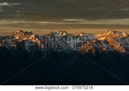 Snow Covered Ridge In Olympic Mountains Of Washington