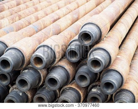 Pipe For Drilling Rigs For Oil And Gas On Background. Drilling Of Oil And Gas Wells. Drill Pipe  Tub