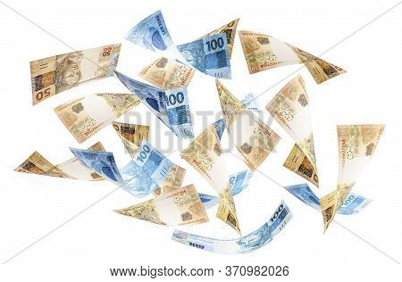 Fifty And One Hundred Reais Bills Falling, Money From Brazil On Isolated White Background. One Hundr