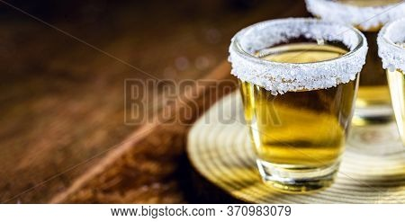 Tequila Shot With Lemon And Sea Salt On Wooden Background, Selected Focus