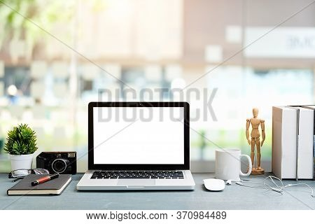 Workspace Desk And Laptop. Copy Space And Blank Screen. Business Image, Blank Screen Laptop And Supp