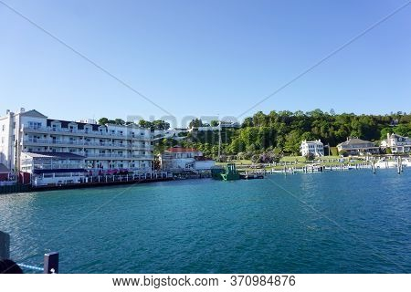 A Green Tugboat Is Docked In The Mackinac Island State Harbor, Mackinac Island, Michigan, During Jun