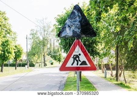 Roadworks Signs On A Street. Traffic Regulation, Rules, Laws And Procedures. Closed Road Sign With A