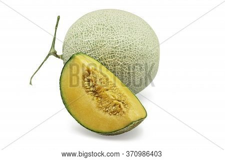 Organic Japanese Cantaloup Melon And A Quarter On White Isolated Background With Clipping Path. Ripe