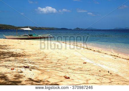 Boat Docked At Calumbuyan Sand Beach Island In Coron, Palawan, Philippines