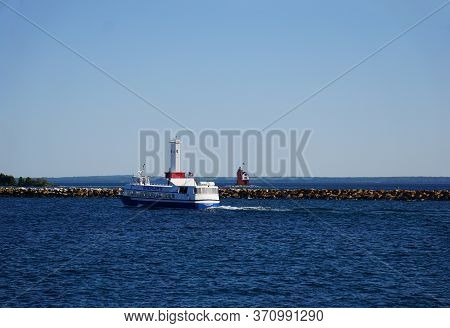 Mackinac Island, Michigan / United States - June 11, 2018: The Captain Shepler Departs The Mackinac