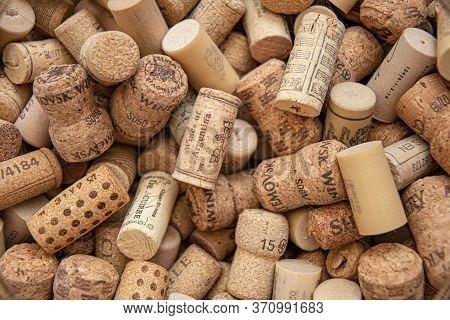 Odessa / Ukraine - 05 22 2020: Old Wine Corks Texture Closeup. Pile Of Various Wine Bottle Corks For
