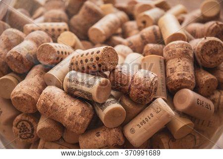 Odessa / Ukraine - 05 22 2020: Selective Focus To Wine Corks Texture. Pile Of Various Wine Bottle Co