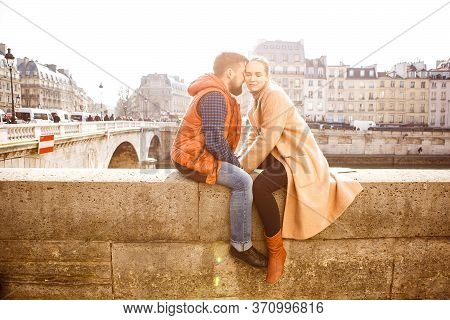 A Couple Man And Woman Walking In Spring Paris. A Romantic Trip Together. Tourism In Europe.