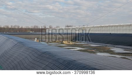Irrigation Basin For A Greenhouse For Growing Tomatoes And Peppers