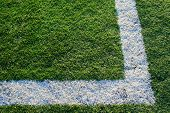Close up of an artificial turf on a sports field. poster