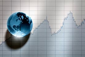 Global economy, crystal glass earth resting on stock market graph