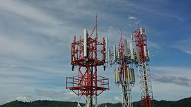 5G telecommunications towers. Cellular phone and data network technology