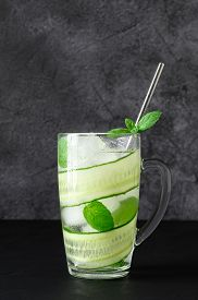 Detox Cold Water With Sliced Cucumber And Mint Leaves In Glasses. Cucumber Cocktail On Dark Backgrou