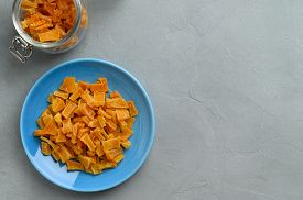 Dried Pumpkin Slices In Bowls On A Gray Stone Background. Candied Pumpkin. Top View, Copy Space.