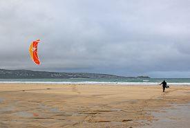 Kitesurfer On The Beach At Gwythian In Cornwall