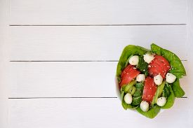 Fresh Vegetable Salad With Tomatoes, Cucumbers And Mozzarella Cheese. Summer Salad With Sesame Seeds