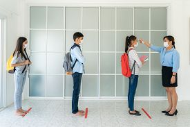 Three Asian Student Wearing Mask Standing Distance Of 6 Feet From Other People Keep Distance While T