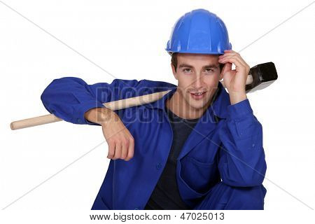 Man casual posing with sledge hammer