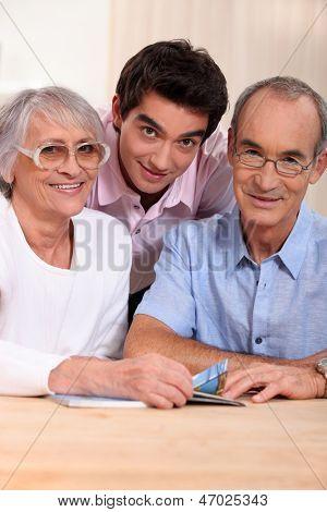 portrait of grandparents with grandson