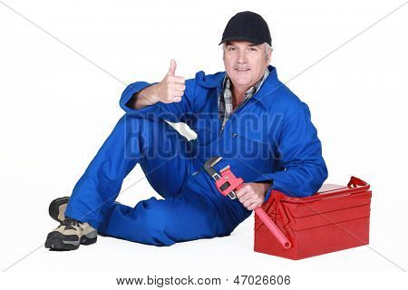 Approving tradesman posing with his tools