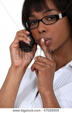 Woman making shush gesture
