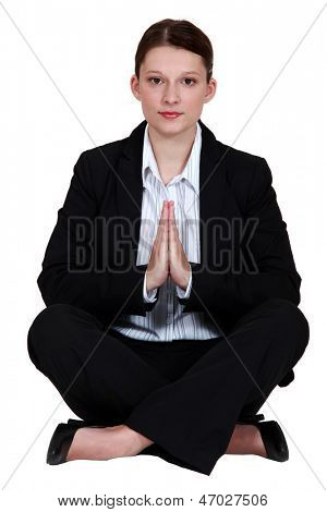 preppy woman in lotus position