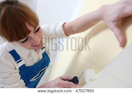Woman, paperhanger