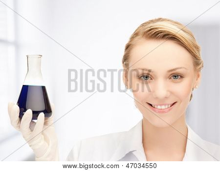 picture of female chemist holding bulb with chemicals