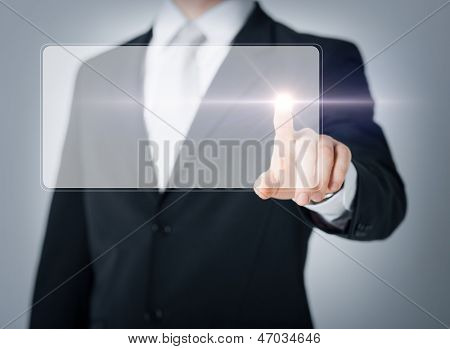 close up of male hand touching virtual screen