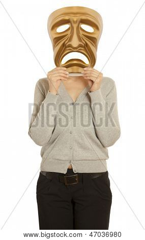 A woman holds a golden theatrical mask of tragedy