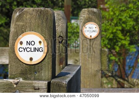 No Cycling Public Information Sign On Gate Post