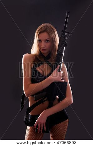 sexy blonde girl holding rifle