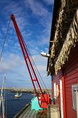 Small fishing port with dried stock fish on Lofoten islands in Norway poster