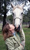 Female rider and horse in the Australian outback poster