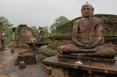 Four seated Buddhas are located in the Vatadage ancient house of relic in Polonnaruwa Sri Lanka. Two of them are shown in the picture. poster