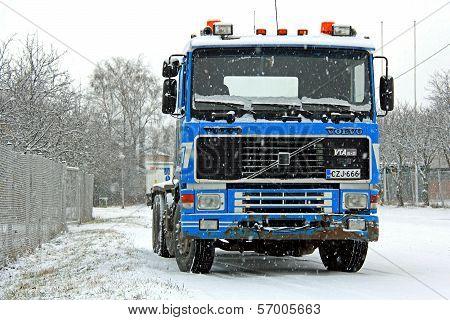 Blue Volvo F16 Truck In Snowfall