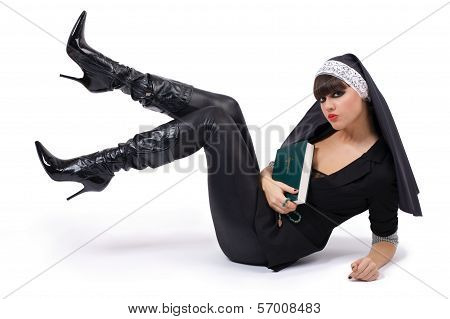 Young Beautiful Nun Sitting On The Floor
