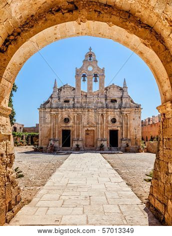 Old monastery behind the Arch. Arkadi monastery - Crete, Greece.