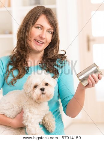Woman owner of small doggy maltese with can of dog food poster
