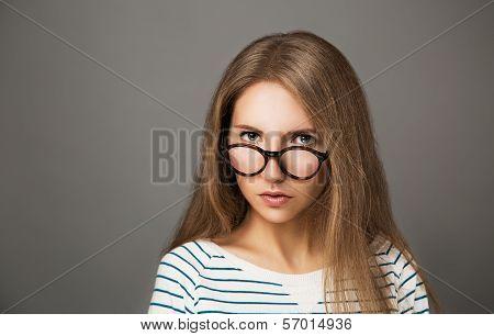Portrait of Trendy Hipster Girl in Glasses
