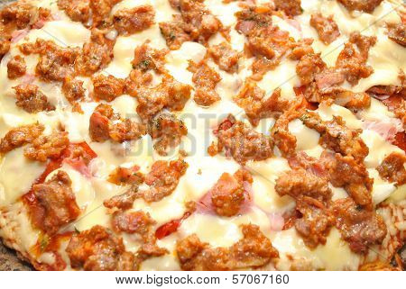 Raw Hot Sausage ontop of a Pizza Pie