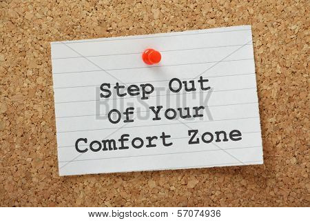 The phrase Step Out of Your Comfort Zone on a paper note pinned to a cork notice board. A concept for moving beyond your current circumstances to embrace new opportunities poster