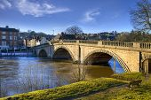 The old bridge spanning the River Severn at Bewdley, Worcestershire, England. poster