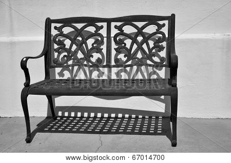 Iron bench and its shadow