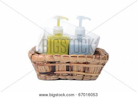 Bottle of Bath gel and herbal body care in water hyacinth basket on white background. poster