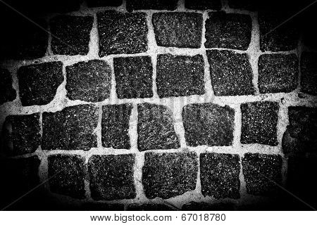 Ray of light on a stone wall, monochrome background poster