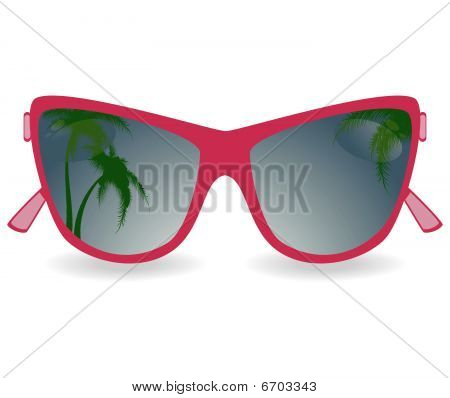 Sun glasses with reflexion of palm trees