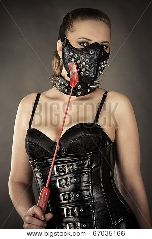 woman in corset and mask with spikes