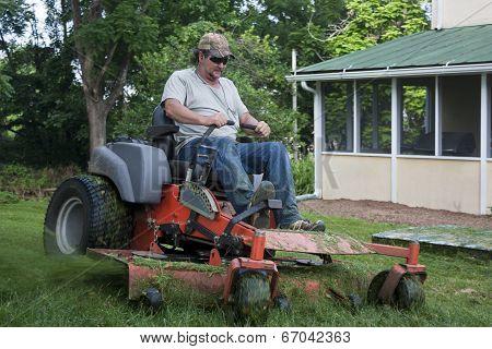 Landscaper on riding lawn mower